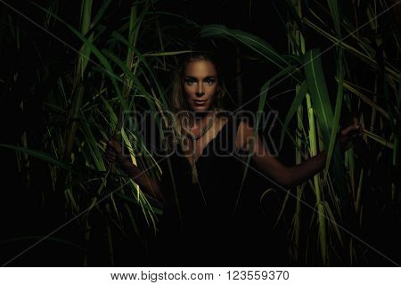 Woman in bamboo garden in the night