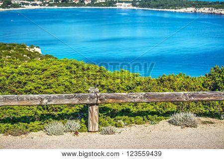 a wooden guardrail in Capo Caccia in Italy
