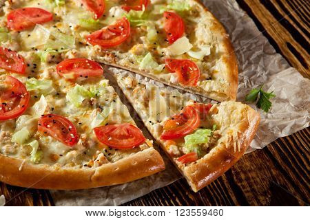 Mozarella and Tomato Pizza Dressed with Salad Leaf