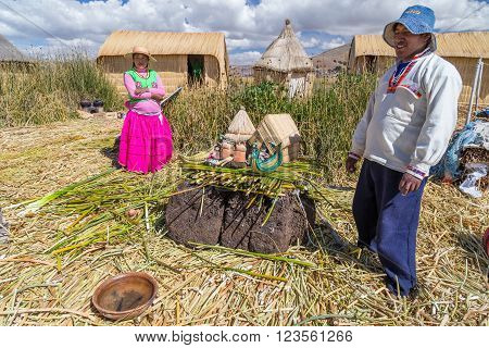 Puno, Peru - Circa June 2015: Family At Uros Floating Island And Village On Lake Titicaca Near Puno,