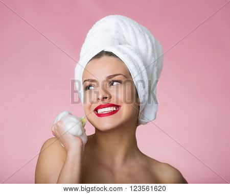Beautiful woman with bath towel and soapy sponge