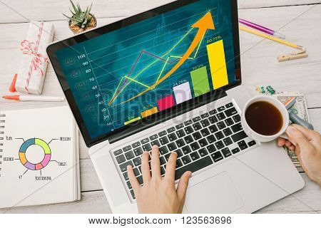 Businessman working with hand holding coffee cup and Strategy Concept.