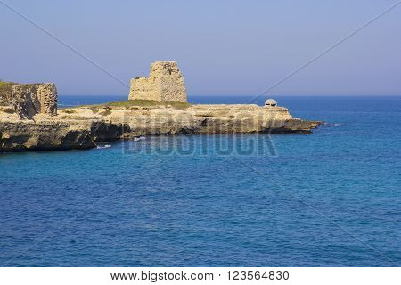 Rocky cliffs on the coast between Roca and Torre dell'Orso in Salento