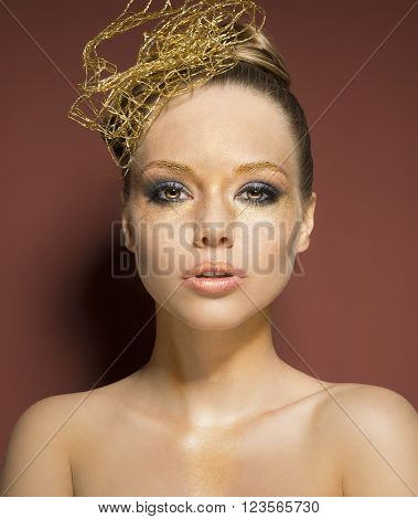 Woman With Cute Golden Make-up