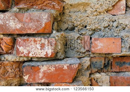 Brick masonry ancient wall. Texture of wall from a red brick. The background of bricks. Brickwork of an old building.