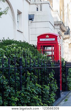 LONDON. Red telephone box on the street.