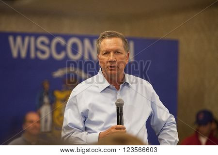 MADISON WI/USA - March 28 2016: Republican presidential candidate John Kasich speaks to a group of supporters during a town hall event before the Wisconsin presidential primary in Madison Wisconsin.