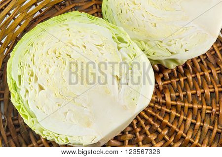 Halved Cabbage In A Wicker Basket