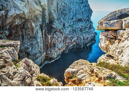cliff and blue sea in Capo Caccia, Sardinia
