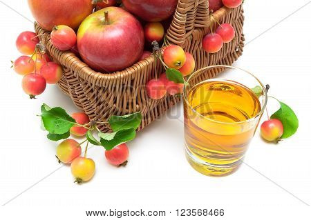 apples in a basket and a glass of apple juice on a white background. horizontal photo.