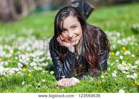 Beautiful woman lying on the grass