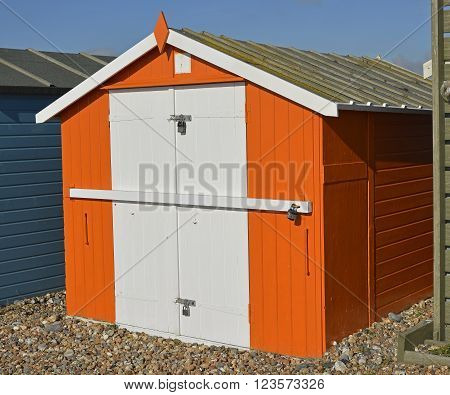Wooden beach hut on shingle beach at Lancing Near Brighton West Sussex England.