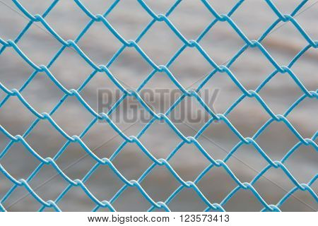 The grid above the water. The texture of the lattice. Latticed ceiling near the water. Iron fence outside.