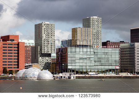 ROTTERDAM - SEP 5 2015: View on Rotterdam's Kop van Zuid neighorhood with it's solar-powered floating pavilion and Inholland University among other buildings.