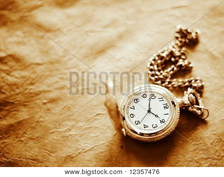 pocket watch on old paper background