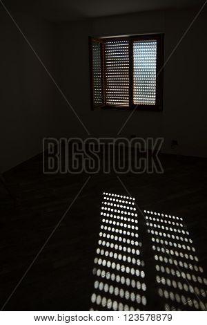 sunlight on the floor in an empty dark room