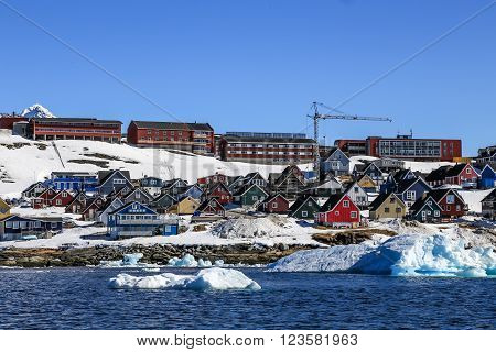 Growing Arctic capital, view from fjord with drifting icebergs, Nuuk city, Greenland