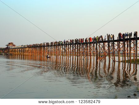 Famous U-Bein teak bridge at sunset on Taungthaman lake in Amarapura, Mandalay division, Myanmar