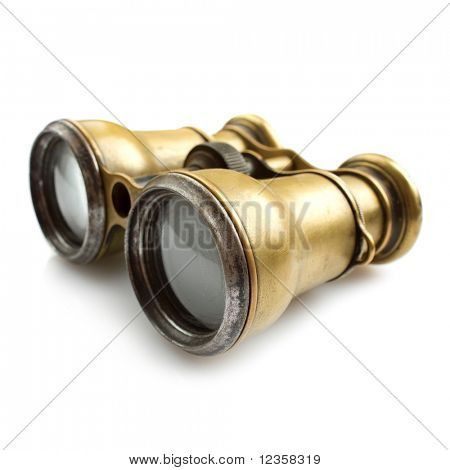 Old binoculars on white background