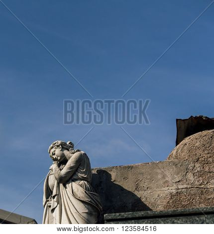 Praying angel in the Recoleta Cemetery argentina