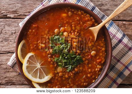 Arabic cuisine: Harira soup in a bowl close-up. horizontal top view