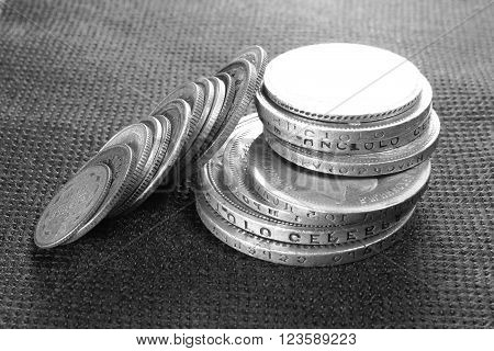 Several ancient silver coins close-up, black and white photo