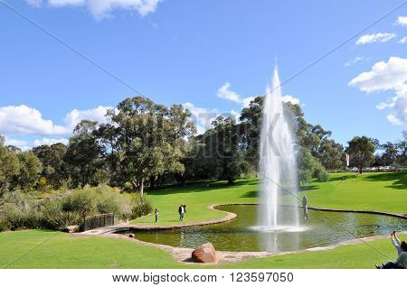 PERTH,WA,AUSTRALIA-AUGUST 22,2015: Pioneer Women's Memorial fountain with tourists at King's Park in Perth, Western Australia.
