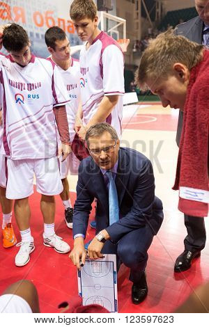 SAMARA RUSSIA - NOVEMBER 06, 2013: BC Krasnye Krylia head coach Sergey Bazarevich during a timeout of the BC Royal Hali Gaziantep basketball game on November 06 2013 in Samara Russia.