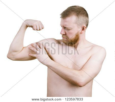 Bearded nude man measures the his biceps