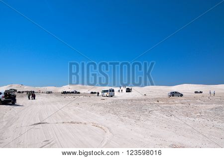 LANCELIN,WA,AUSTRALIA-SEPTEMBER 28,2015: People and recreational vehicles at the white sand dunes tourist attraction in Lancelin, Western Australia.