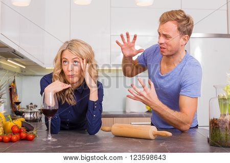 Couple arguing with each other in kitchen