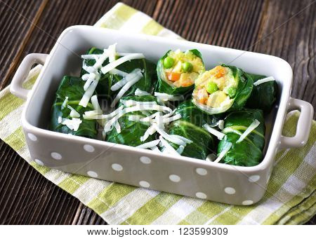 Gourmet chard roll with potatoes, peas, carrots and goat cheese.