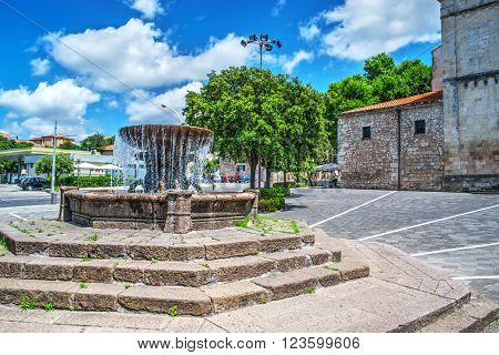 fountain under a blue sky with clouds in Sassari Italy