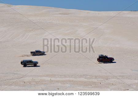 LANCELIN,WA,AUSTRALIA-SEPTEMBER 28,2015: All terrain recreational vehicles racing across the white sand dunes in Lancelin, Western Australia.
