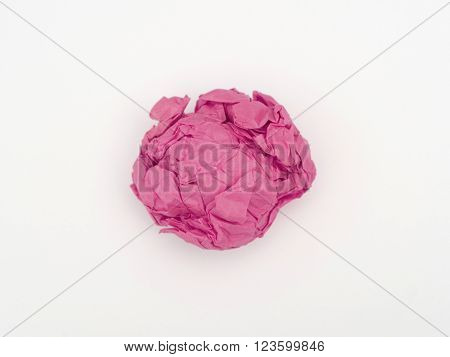 pink crumpled paper ball in white background