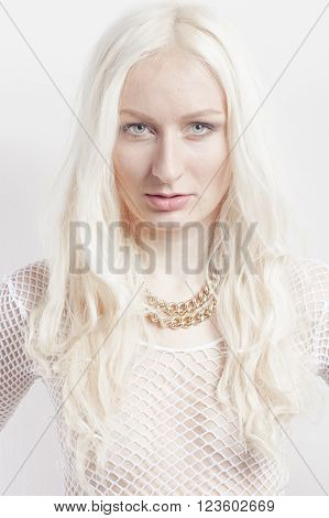 Blonde with golden chain and see trough shirt