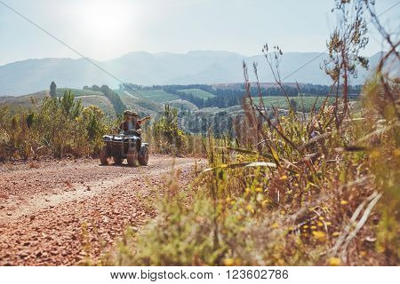 Young Couple Having Fun On Quad Bike