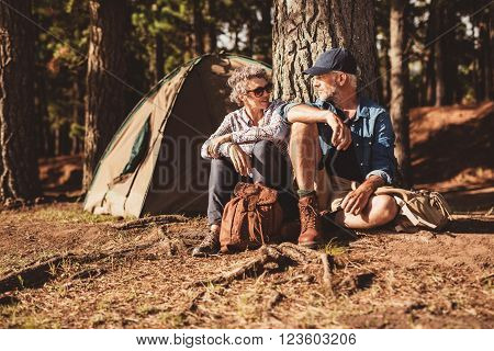 Happy Senior Couple Camping In Forest