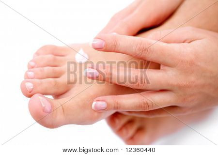 Young woman cares about her foots, applying cream on them.
