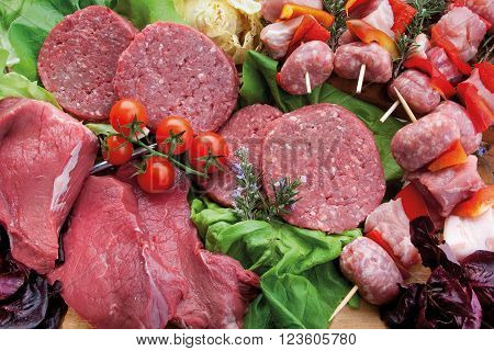 Composition of meat beef sausage and hamburger with tomatoes