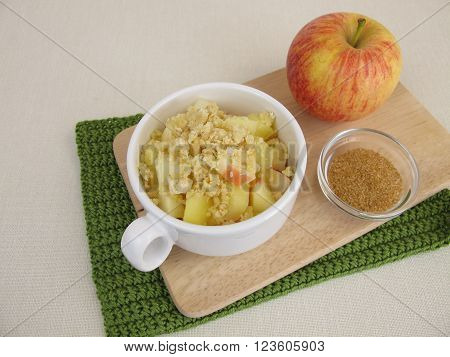 Crumble mug cake with apple, cinnamon and sugar