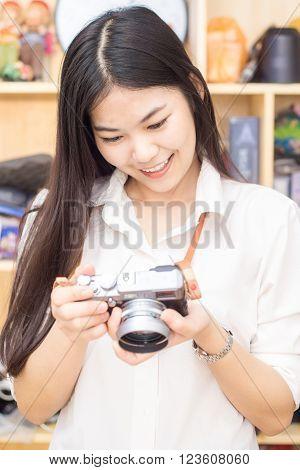 Female Asian Photographer With Mirrorless Camera