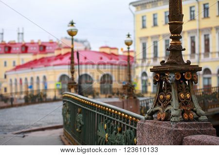 St. Petersburg Russia fragments of architecture. The base of a street lamp on the Theatrical bridge on the background of buildings