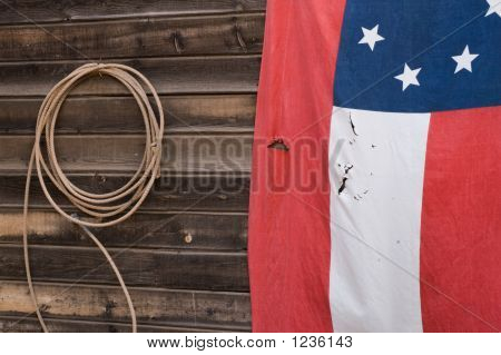 Old Flag And Lasso Rope
