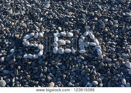 The Sign Sea Made From White Pebbles On Pebble Beach On The Sea