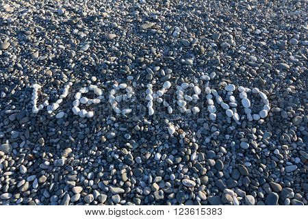 The Sign Weekend Made From White Pebbles On Pebble Beach On The Sea