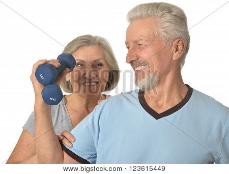 Portrait Of  Senior Couple Standing With Dumbbells On White Background