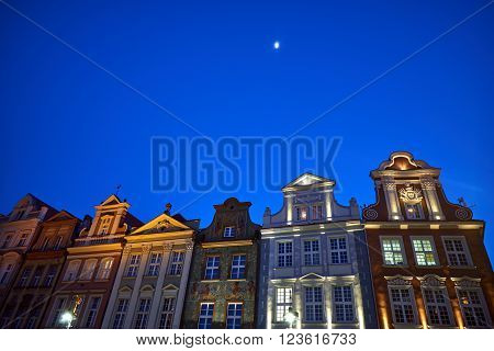 Townhouses and moon during the night in the Old Market Square in Poznan ** Note: Soft Focus at 100%, best at smaller sizes