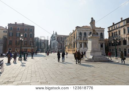 Venice, Italy - Febuary 19, 2016: Campo Santo Stefano, a city square in Venice. Venice is famous for its settings, archtecture and artwork. A part of Venice is resignated as a World Heritage site.