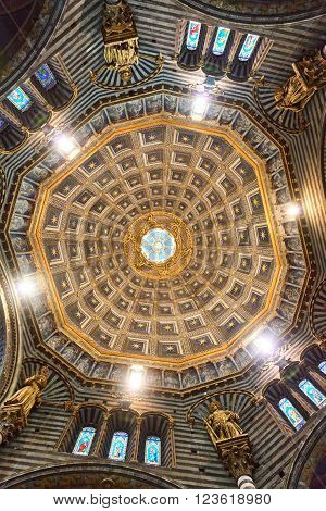 Siena, Italy - Febuary 16, 2016: Dome of Duomo di Siena (Santa Maria Assunta), a medieval church built in the Romanesque and Italian Gothic style between 1215 and 1263.